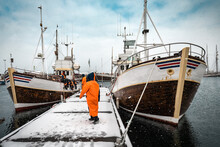 Fishermen Are Preparating The Ships For Fishing In Severe North