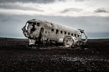 American Plane Wreck On A Black Sand Beach In The Middle Of Iceland