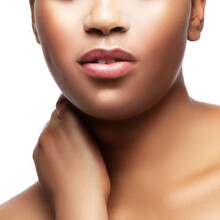 Lips. Close-up Face Of  Young African Beauty Woman Healthy Skin Hapy Young Model Isolated