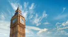 Big Ben Clock Tower In London, UK, On A Bright Day. Panoramic Composition Withcopy-space, Text Space On Blue Sky With Feather Clouds.