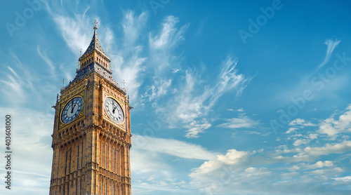 Big Ben Clock Tower in London, UK, on a bright day. Panoramic composition withcopy-space, text space on blue sky with feather clouds. © tilialucida