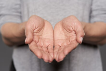 Woman's Hands Offering Support