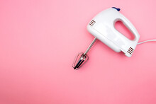 Electric Blender With Stirring Attachments On Solid Pink Background