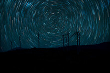 The Stars Night Of Startails Over Of Wind Turbines At Khao Kho District, Phetchabun Thailand.