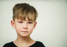 Portrait Of An Offended And Crying Boy Close-up