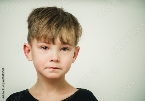 Canvas Print portrait of an offended and crying boy close-up