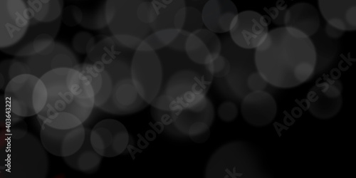 Fototapeta Abstract black and white bokeh background for creative design. Celebratory blurred backdrop. obraz