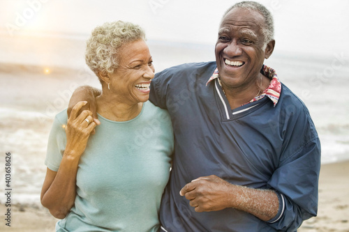 Happy Senior African American Couple on the Beach Wallpaper Mural