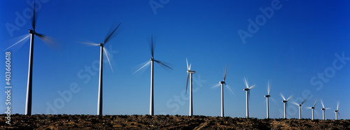 Obraz Photo of Spinning Wind Turbines - fototapety do salonu