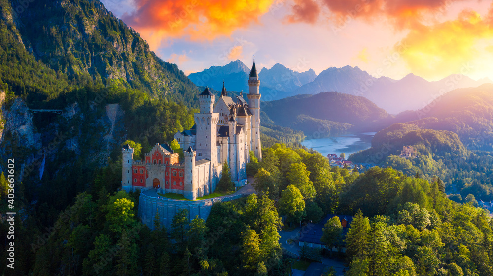 Fototapeta Beautiful view of world-famous Neuschwanstein Castle, the nineteenth-century Romanesque Revival palace built for King Ludwig II on a rugged cliff near Fussen, southwest Bavaria, Germany.