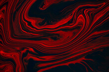 Fluid Art Texture. Abstract Backdrop With Mixing Paint Effect. Liquid Acrylic Picture That Flows And Splashes. Mixed Paints For Posters Or Wallpapers. Black, Red And Orange Overflowing Colors