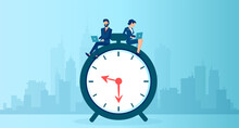 Vector Of A Business Man And Businesswoman Using  Laptop Sitting On A Clock Working Long Hours