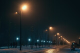 Urban alley in foggy winter night illuminated by street lamps.