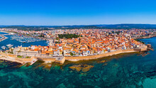 Aerial View Over Alghero Old Town, Cityscape Alghero View On A Beautiful Day With Harbor And Open Sea In View. Alghero, Italy. Panoramic Aerial View Of Alghero, Sardinia, Italy.