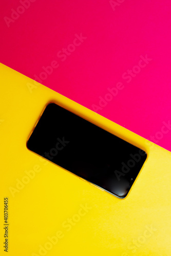 Fototapeta Empty phone isolated on pink yellow background with copy space. obraz na płótnie