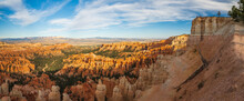 Bryce Canyon National Park Amphitheater, Panoramic View. Sandstone Spires And Pine Tree Forest With Beautiful Blue Sky On Background