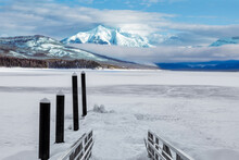 Winter Landscape Of Frozen Lake McDonald Dock In Glacier National Park, Montana