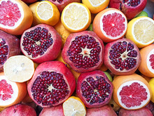 Ripe Fresh Fruits Background. Pomegranates, Oranges, Lemon And Grapefruit Are Juicy For Juice. Fresh Fruits Mixed
