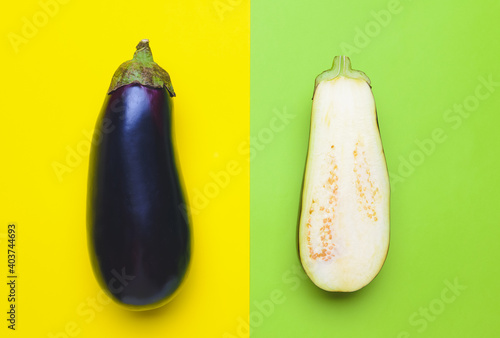 Obraz na plátně Fresh and sliced eggplants on color background