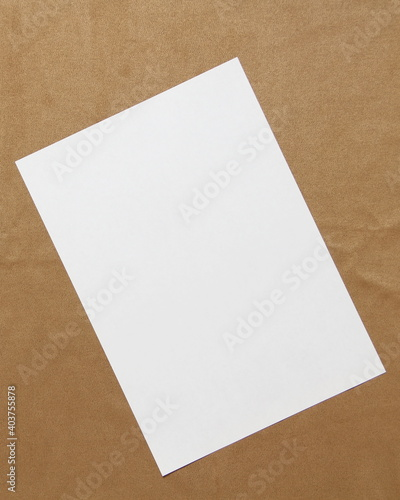 Template of white paper lies diagonally on light brown cloth background Poster Mural XXL