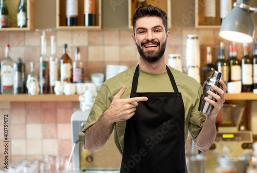 Fototapeta alcohol drinks, people and job concept - happy smiling barman with shaker prepar