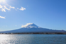 Mount Fuji Is In Front Of A Lake. There Is A Blue Sky As The Copy Space Background.