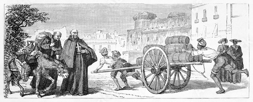 Fotografie, Obraz guys transporting water barrels on a cart outdoor in Naples street, Italy, and two friars with mule