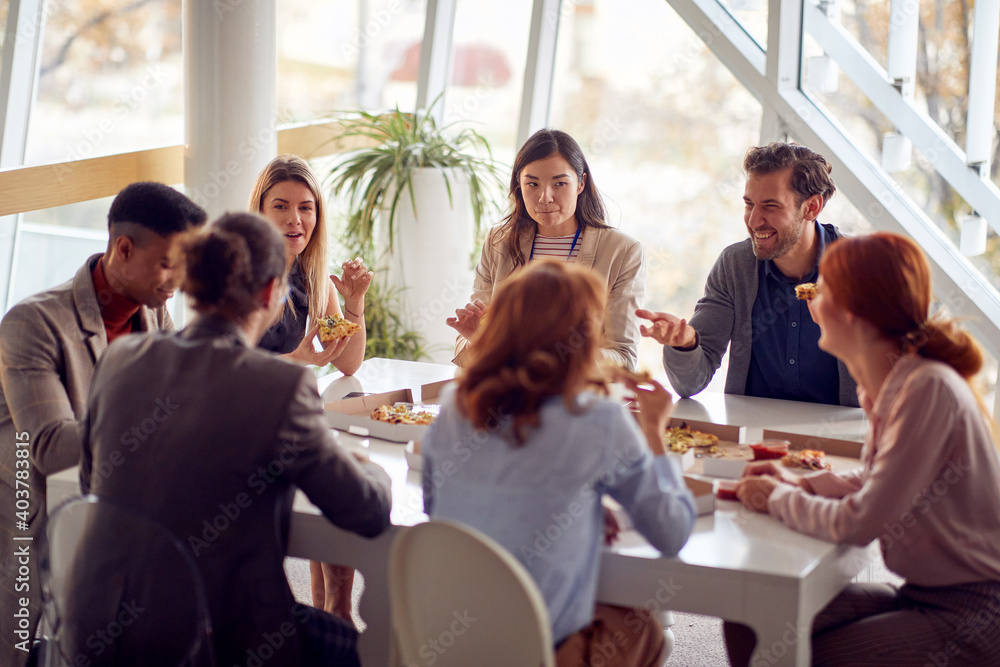 Fototapeta Employees having a good time at lunch break at company canteen. People, job, company, business concept.