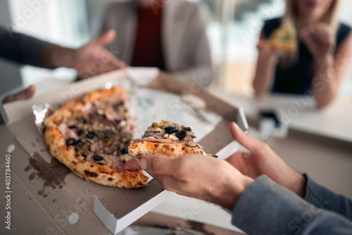 Fotografie, Obraz Pizza on today's menu in a break at company's canteen