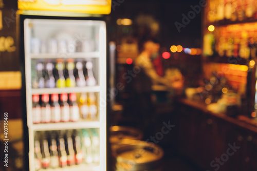 Obraz Background Blurred Defocused Beers are cooling in fridge, freezer or refrigerator shelf. - fototapety do salonu
