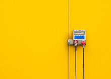 Close Up Of Electric Cables On Yellow Wall