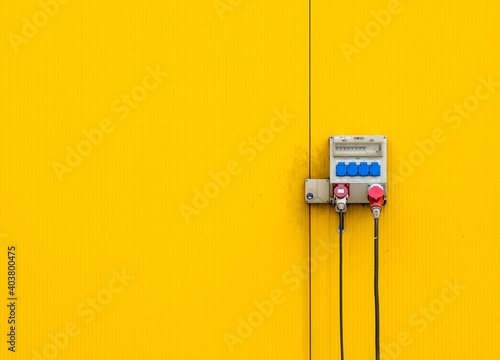 close up of electric cables on yellow wall Fototapeta