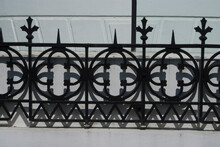 Close Up Detail Of Wrought Iron Railings.