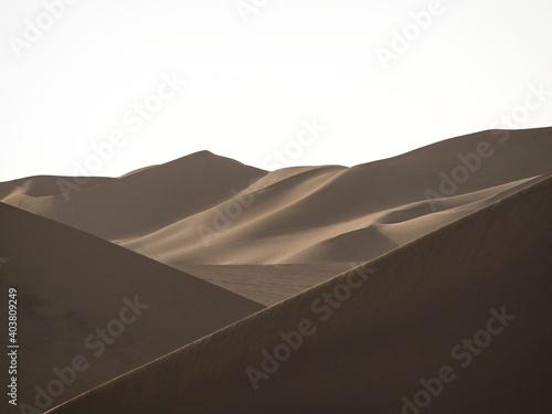 Obraz na płótnie Panoramic postcard view of dry sand dunes texture pattern coastal desert oasis o