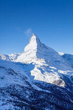 The Matterhorn Face East And Face North In Morning Light In Winter, Photo Taken From The Hiking Trail From Blauherd To Fluhalp, Above Zermatt In Valais, Switzerland.