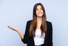 Young Brazilian Business Woman Over Isolated Blue Background Holding Copyspace Imaginary On The Palm