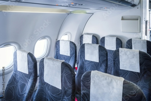 Tela Airplane cabin and comfortable seats in economy class