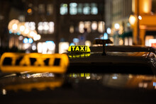 Yellow TAXI Signs On The Taxis Captured At Night