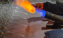Glassblower Blows Glass Balls From Glass Tubes Burner With High Temperature Propane Flame Close-up Glassblower Hand