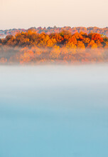 Hilltop Fall Foliage Surrounded By Clouds At Sunrise
