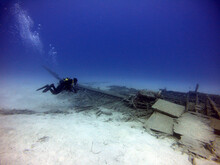 Underwater Diving Photographer Taking Pictures Over An Old Wreck