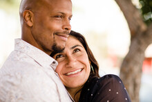 Multiracial Late Forties Couple Embracing On San Diego Sidewalk