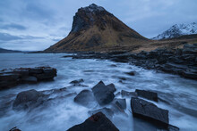 Slettind Mountain Peak Rises Above Broken Stone Breakwater Jetty At Myrland, Flakstad√∏y, Lofoten Islands, Norway