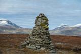 Rock cairn marking summit of Stuorajåbba (926m) along Kungsleden Trail north of Ammarnäs, Lapland, Sweden