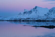 Winter Twilight Glows Over Mountains Of Flakstad√∏y, Lofoten Islands, Norway