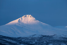 First Light Shines Over Summit Of Fugltinden, Troms, Norway