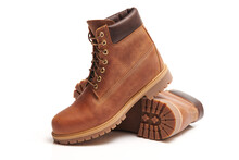 Pair Of Mens Leather Brown Waterproof Boots For Winter Or Autumn Hiking Isolated On White Background. Mens Fashion, Trendy Footwear. Close Up View.