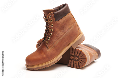 Fotografiet Pair of Mens leather brown waterproof boots for winter or autumn hiking isolated on white background