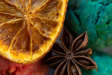 Spices And Candied Fruits Close-up. Star Anise And Dried Orange On The Background Of Colorful Cookies. The Concept Of The Winter Food