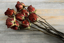 Bouquet Of Withered Roses On A Wooden